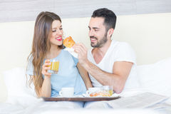 Couple Having Breakfast on Bed Royalty Free Stock Image