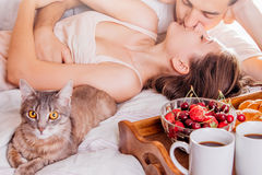 Couple having breakfast in bed Royalty Free Stock Photography
