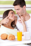 Couple having breakfast in the bed Stock Images