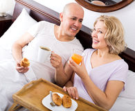 Couple having breakfast in bed Royalty Free Stock Photo