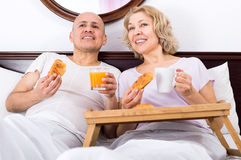 Couple having breakfast in bed Stock Image