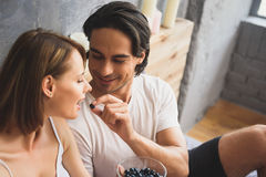 Couple having breakfast in the bedroom Royalty Free Stock Images