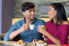 Couple having breakfast at coffee bar Royalty Free Stock Image