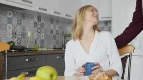 Couple having breakfast at home stock footage