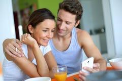 Couple having breakfast at home Stock Photo