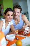 Couple having breakfast at home Royalty Free Stock Photos