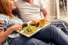 Couple having breakfast at home Stock Images