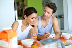 Couple having breakfast at home Stock Image