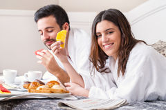 Couple having breakfast in hotel room. Royalty Free Stock Image