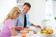 Couple Having Breakfast Before Husband Leaves For Work Stock Image