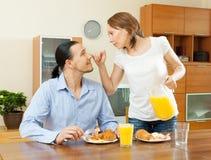 Couple having breakfast with juice Stock Photo