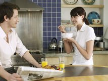 Couple Having Breakfast At Kitchen Table Royalty Free Stock Images