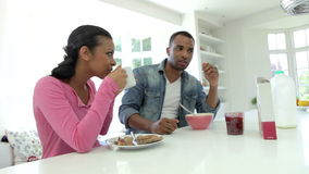 Couple Having Breakfast In Kitchen Together stock video footage