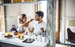 Couple having breakfast in morning Royalty Free Stock Photos