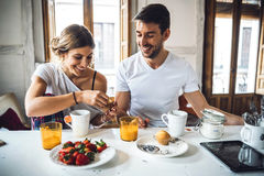 Couple having breakfast in morning stock images