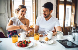 Couple having breakfast in morning royalty free stock photo