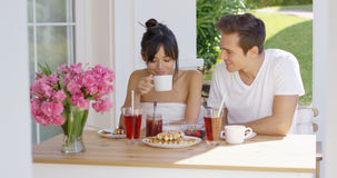 Couple having breakfast at outdoor table Stock Photography