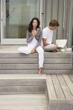 Couple Having Breakfast On Porch Stock Photos