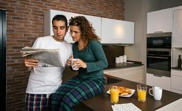 Couple having breakfast and reading newspaper Royalty Free Stock Photography
