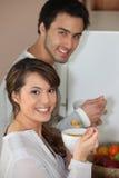 Couple having breakfast standing up Stock Photos