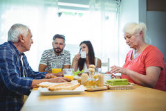 Couple having breakfast with their parents royalty free stock images