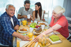 Couple having breakfast with their parents stock photo