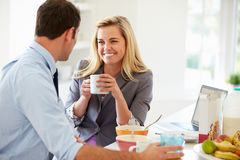 Couple Having Breakfast Together Before Leaving For Work Stock Image