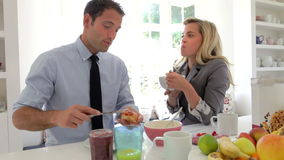 Couple Having Breakfast Together Before Leaving For Work stock footage