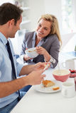 Couple Having Breakfast Together Before Leaving For Work Royalty Free Stock Photo