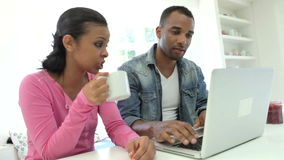 Couple Having Breakfast Using Laptop In Kitchen Together stock footage