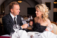Couple having a celebration in restaurant Royalty Free Stock Image