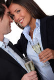 Couple having a celebratory drink royalty free stock photography