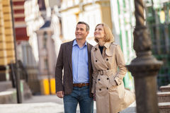 Couple having city break in summer walking on street. stock photo