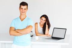 Couple having coffee-break brainstorm. Focus on the man. royalty free stock image