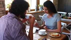 Couple having coffee in cafe stock video