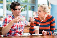 Couple having coffee in a street cafe. Couple, women and man, having coffee in a street cafe in Berlin stock images