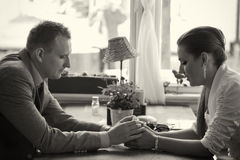 Couple having conversation. A couple having a conversation on a table, holding hands Royalty Free Stock Image