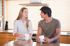 Couple having a cup of coffee Royalty Free Stock Photos