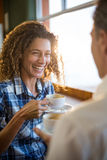 Couple having a cup of tea in super market Stock Photography
