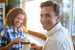 Couple having a cup of tea in supermarket Royalty Free Stock Photos