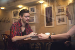 Couple is having a date in cafe. They drink coffee Stock Image
