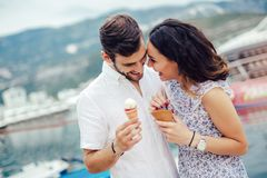Couple having date and eating ice cream on vacation. Sea background. Happy couple having date and eating ice cream on vacation. Sea background royalty free stock photos