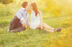 Couple having date, spending great time in garden. Royalty Free Stock Photography
