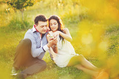 Couple having date, spending great time in garden. Stock Photos