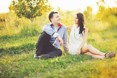 Couple having date, spending great time in garden. Royalty Free Stock Image