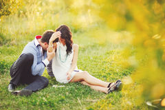 Couple having date, spending great time in garden. Royalty Free Stock Photos
