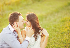 Couple having date, spending great time in garden. Royalty Free Stock Photo