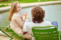 Couple having a date in the Tuileries garden Stock Photo