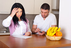 Couple having difficult to calculate expenses Royalty Free Stock Photos