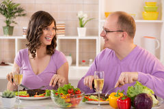 Couple having dinner. Happy Couple having dinner in a kitchen Stock Photos